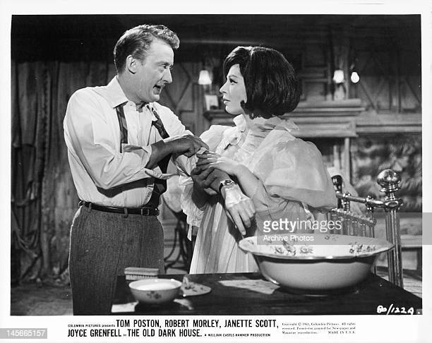 Fenella Fielding holding Tom Poston's arm in a scene from the film 'The Old Dark House' 1963