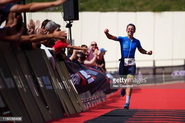 Fenella Langridge of Great Britain celebrates winning the women's race of IRONMAN 703 Barcelona on May 19 2019 in Calella Spain