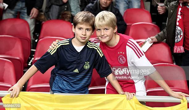 Fenerbahce and Ajax fans show their support during UEFA Europa League Group A match between Ajax and Fenerbahce at Amsterdam Arena Stadium in...