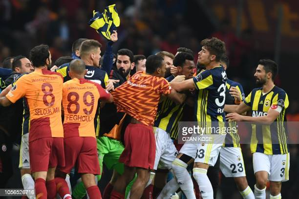 Fenerbahce and Galatasaray players fight at the end of the Turkish Spor Toto Super league fotball match between Galatasaray and Fenerbahce on...