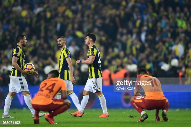 Fenerbahce and Galatasaray's players reacts after a draw end of Turkish Spor Toto Super league fotball match between Fenerbahce and Galatasaray on...