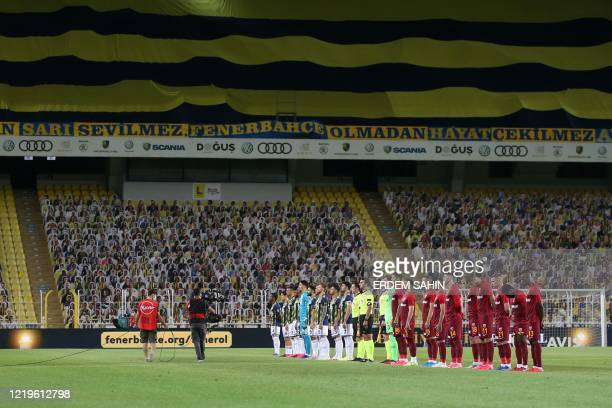 Fenerbahce and Kayserispor's players attend the opening ceremony in front of cardboards with photographs of Fenerbahce fans on the stands ahead of...