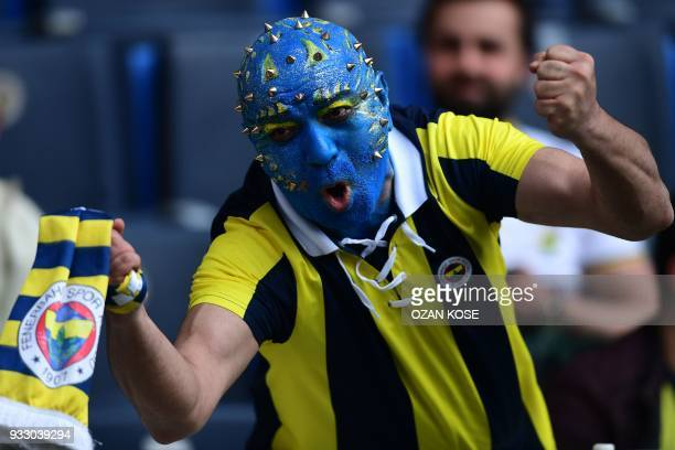 Fenerbahce fan cheers his team before the Turkish Super Lig football match between Fenerbahce and Galatasaray on March 17 at the Fenerbahce Ulker...