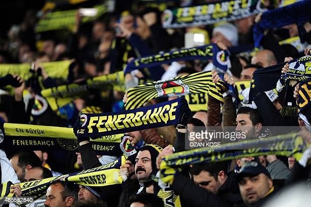 Fenerbahce fans cheer their team before start the Turkish Sport Toto Super League football match Fenerbahce vs Galatasaray at the Fenerbahce Sukru...
