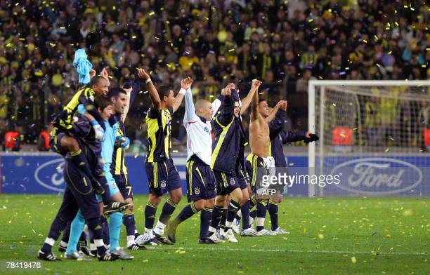 Fenerbahce Istanbul's players celebrate after their teammate Ugur Boral's scored a goal against CSKA Moscow during their Champions League group G...