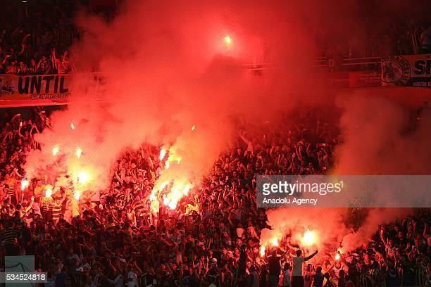 Fenerbahce soccer fans light torches as they support their team during the Ziraat Turkish Cup Final match between Galatasaray and Fenerbahce at...