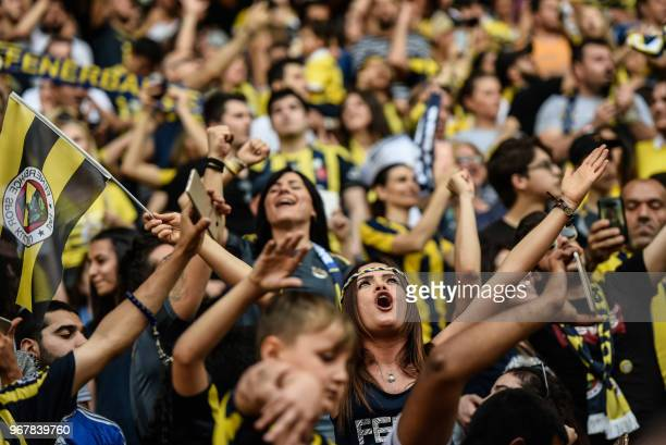 Fenerbahce supporters holds scarves during a gathering with the newly elected Fenerbahce chairman at the Ulker Stadium in Istanbul on June 5 in...