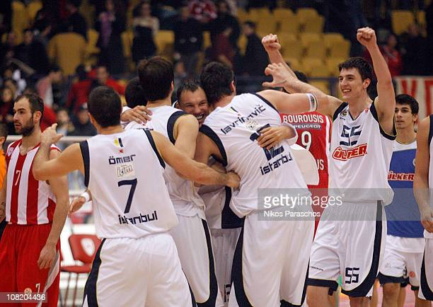 Fenerbahce Ulker Istanbul teammates celebrate during the 20102011 Turkish Airlines Euroleague Top 16 Date 1 game between Olympiacos Piraeus vs...