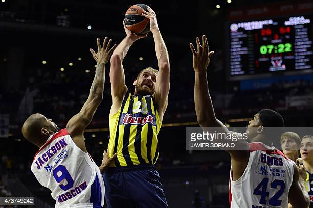 Fenerbahce Ulker's Croatian center Luka Zoric vies with CSKA Moscow's US guard Aaron Jackson and CSKA Moscow's US forward Kyle Hines during the...