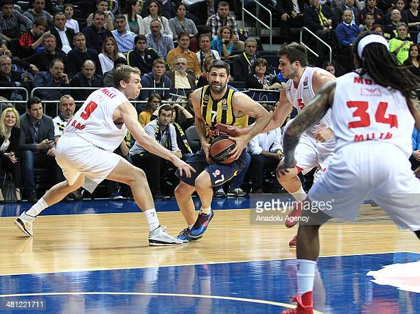Fenerbahce Ulker's Omer Onan vies with EA7 Emporio Armani's Nicolo Melli and Alessandro Gentile during the Turkish Airlines Euroleague Top 16 Round...