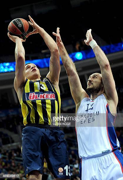 Fenerbahce Ulker's Serbian forward Bogdan Bogdanovic vies for the ball with Anadolu Efes's Serbian Center Nanad Krstic during the Euroleague Top 16...