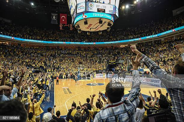 Fenerbahce Ulker's supporters cheer their team during the Euroleague playoff second match between Fenerbahce Ulker and Real Madrid on April 14 2016...