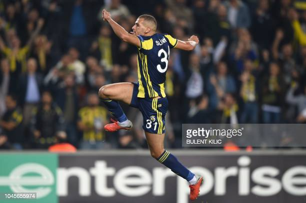 Fenerbahce's Algerian forward Islam Slimani celebrates after scoring a goal during the Europa League Group D match between Fenerbahce and Spartak...