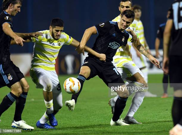 Fenerbahce's Algerian forward Yassine Benzia fights for the ball with Dinamo Zagreb's Croatian midfielder Ivan Sunjic and Dinamo Zagreb's Bosnian...