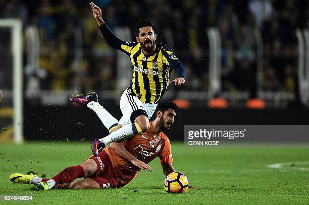 Fenerbahce's Alper Potuk vies with Galatasaray's Hakan Balta during the Turkish Super Lig football match between Fenerbahce and Galatasaray at the...
