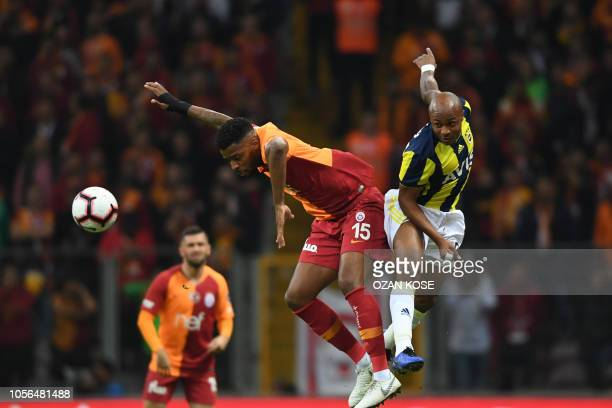 Fenerbahce's Andre Ayew vies for the ball with Galatasaray's Ryan Donk during Turkish Spor Toto Super league fotball match between Galatasaray and...