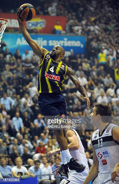 Fenerbahce's Bo McCalebb goes for the basket past Belgrade's Bogdan Bogdanovic during the Euroleague group A basketball match between Partizan...