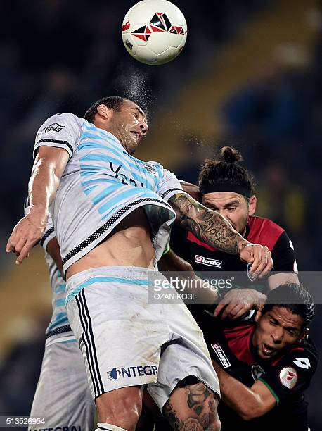 Fenerbahce's Brazilain forward Fernandao heads the bal next to Amedspor's Kamil Icer during the Zirrat Tukish Cup football match between Fenerbahce...