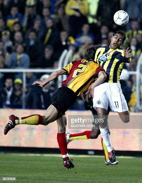 Fenerbahce's Brazilian Marcio Nobre fights for the ball with Galatasaray's Omer Erdogan during their Turkish Super League match at Sukru Saracoglu...