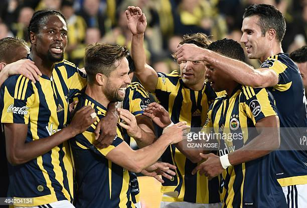 Fenerbahce's Brazilian midfielder Diego Ribas celebrates with teammates after scoring a goal during the Turkish Super Lig football match between...