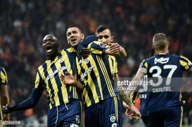 TOPSHOT Fenerbahce's Brazilian midfielder Josef de Souza celebrates after scoring a goal during the Turkish Super Lig football match between...