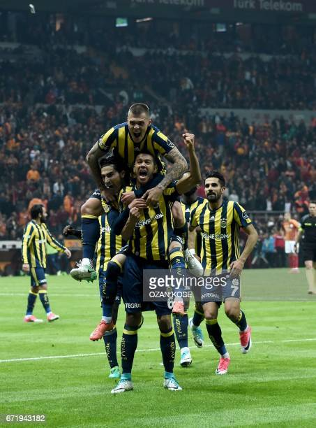 Fenerbahce's Brazilian midfielder Josef de Souza celebrates with his team mates after scoring a goal against Galatasaray during the Turkish Spor Toto...