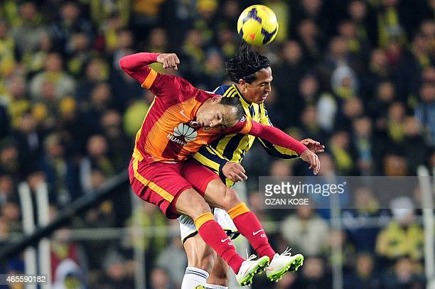 Fenerbahce's Bruno Alves fights for the ball with Galatasaray's Umut Bulut on March 8 2015 during the Turkish Sport Toto Super League football match...