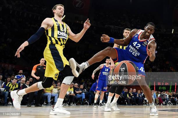 Fenerbahce's Czech centre Jan Vesely challenges Anadolu Efes' USArmenian centre Bryant Dunston during the EuroLeague semifinal basketball match...