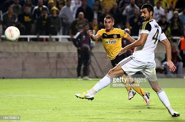 Fenerbahce's defender Bekir Irtegun challenges AEL Limassol's midfielder Monteiro as he attempts to score during the UEFA Europa League group C...