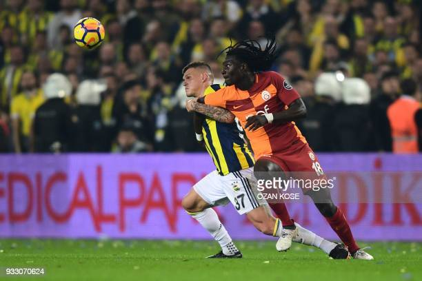Fenerbahce's defender Martin Skrtel vies for the ball with Galatasaray's Bafetimbi Gomis during Turkish Spor Toto Super league fotball match between...