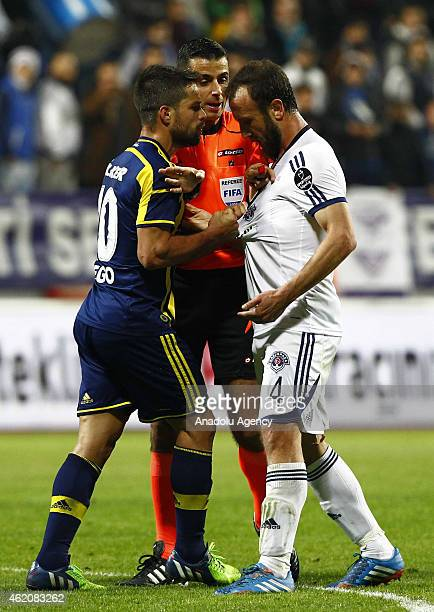Fenerbahce's Diego Ribas da Cunha argues with Kasimpasa's Ilhan Eker during the Turkish Spor Toto Super League soccer match between Kasimpasa and...
