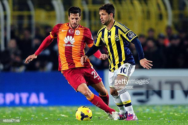 Fenerbahce's Diego Ribas vies for the ball with Galatasaray's Hakan Balta during the Turkish Sport Toto Super League football match Fenerbahce vs...
