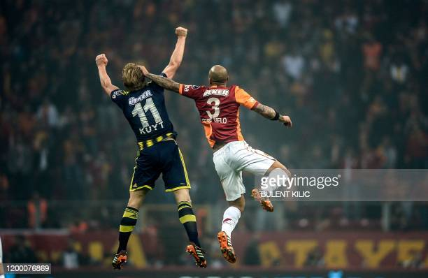 Fenerbahce's Dirk Kuyt vies in the air with Galatasaray's Felipe Melo during the Turkish Super League football match between Fenerbahce and...