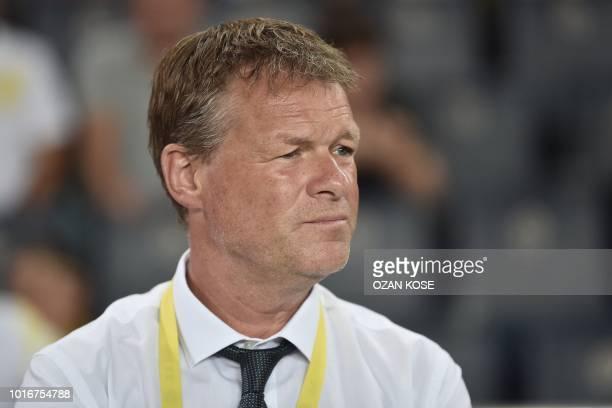 Fenerbahce's Dutch assistant coach Erwin Koeman looks on before the UEFA Champions League third round second leg qualifying football match Fenerbahce...