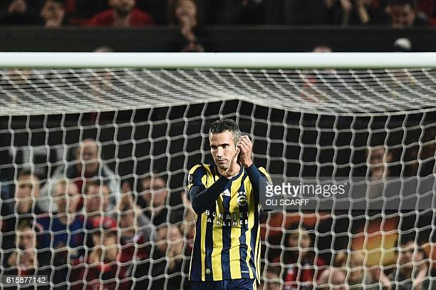 Fenerbahce's Dutch forward Robin van Persie applauds the crowd as he receives an ovation from them after scoring Fenerbahce's first goal during the...