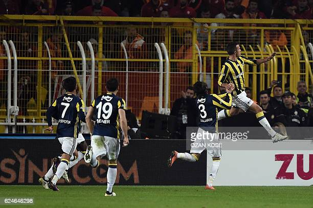 Fenerbahce's Dutch forward Robin Van Persie celebrates after scoring a goal during the Turkish Super Lig football match between Fenerbahce and...