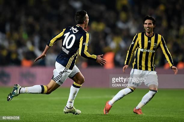 Fenerbahce's Dutch forward Robin Van Persie celebrates with his teammate Hasan Ali Kaldirim after scoring a goal during the Turkish Spor Toto Super...