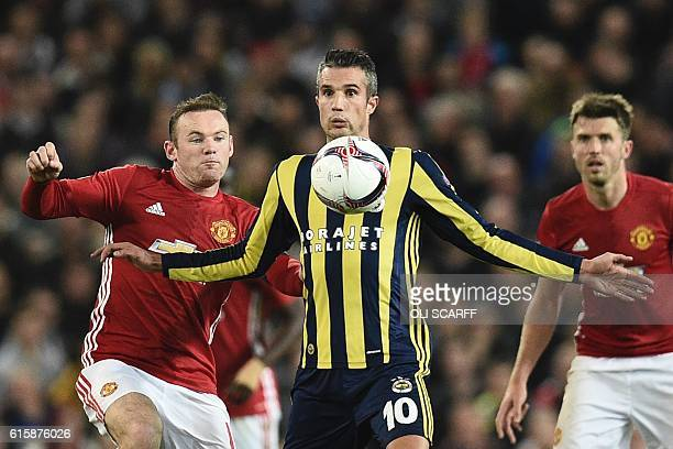 Fenerbahce's Dutch forward Robin van Persie controls the ball under pressure from Manchester United's English striker Wayne Rooney during the UEFA...