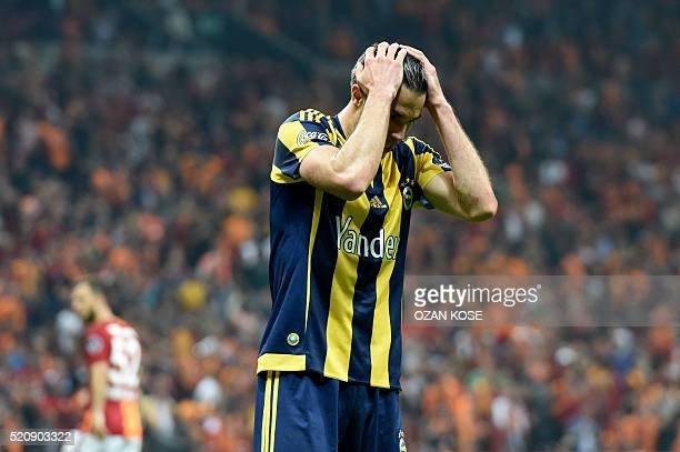 Fenerbahce's Dutch forward Robin Van Persie reacts during the Turkish Spor Toto Super league football match between Galatasaray and Fenerbahce at TT...