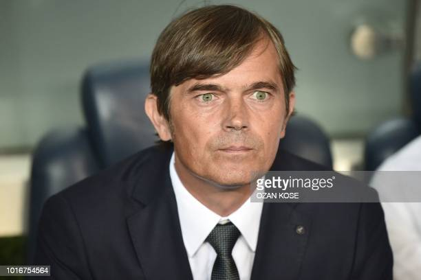 Fenerbahce's Dutch head coach Phillip Cocu looks before the UEFA Champions League third round second leg qualifying football match Fenerbahce SK vs...