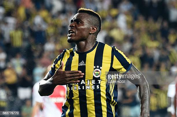 TOPSHOT Fenerbahce's Emmanuel Emenike celebrates after scoring a goal during the Champions League Third qualifying round game between Fenerbahce and...