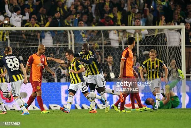 Fenerbahce's Emre Belezoglu celebrates his goal with a teammate during the Turkish Super League football match between Fenerbahce and Galatasaray, at...