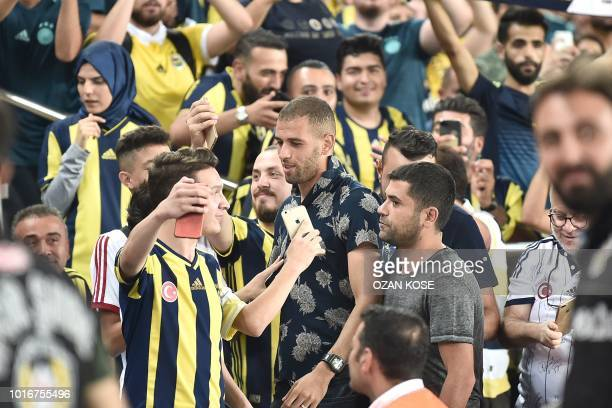 Fenerbahce's fans cheer newly transfer Algerian Islam Slimani during UEFA Champions league third round second leg qualifying football match between...