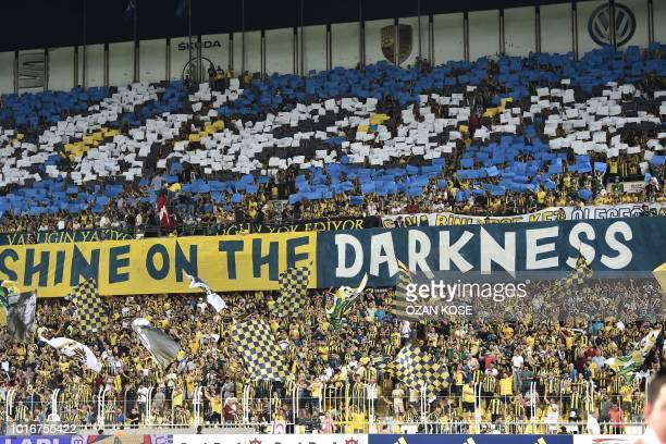 Fenerbahce's fans cheer their team during UEFA Champions league third round second leg qualifying football match between Fenerbahce SK and SL Benfica...
