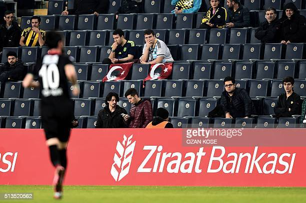 Fenerbahce`s fans display Turkish flags with a portrait of Mustafa Kemal Ataturk founder of modern Turkey during the Zirrat Tukish Cup fotball match...