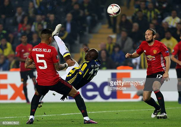 Fenerbahce's forward Moussa Sow kicks the ball next to Manchester United's defender Marcos Rojo and Daley Blind during the UEFA Europa League...