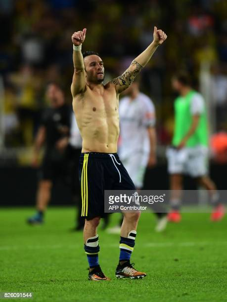 Fenerbahce's French midfielder Mathieu Valbuena celebrates after the UEFA Europa League third qualifying round second match between Fenerbahce and...