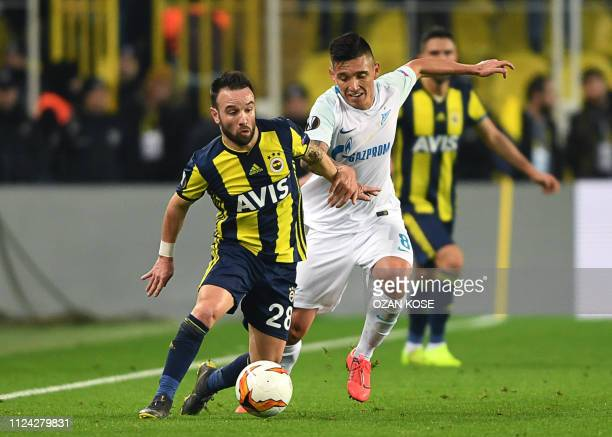 Fenerbahce's French midfielder Mathieu Valbuena fights for the ball with Zenit St Petersburg's Argentine midfielder Claudio Kranevitter during the...