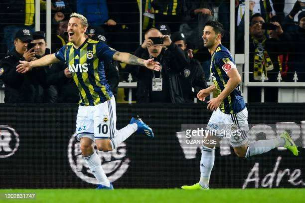 Fenerbahce's German midfielder Max Kruse celebrates with teammates after scoring a goal during the Turkish Super League football match between...