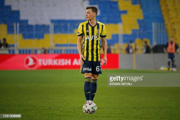 Fenerbahce's German midfielder Mesut Ozil prepares for a free kick during the Turkish Super League football match between Fenerbahce S.K. And...